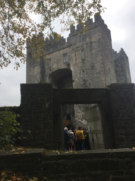View of Bunratty Castle through the front gate at Bunratty Castle and Folk Park